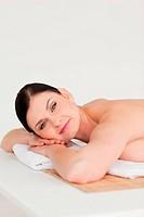 Cute brunette relaxing in a spa centre