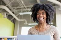 Portrait of businesswomen using laptop in office