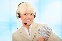 Business woman with headset holding dollars.Over abstract blue background