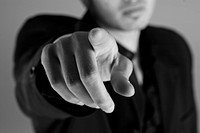 Close_up of a businessman pointing his finger