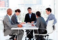 A diverse business group disscussing a budget plan