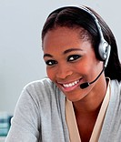 Delighted Afro_american businesswoman using headset
