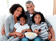 Afro_American family watching television at home