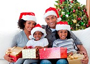 Afro_American family holding Christmas presents