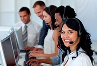 Business team working in a call center with a ma ger