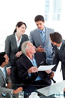 Multi_ethnic business people discussing a contract