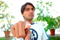A young man pointing finger