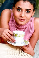 Close up of a woman drinking tea