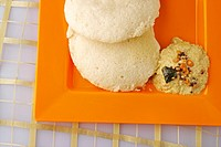 Idli and chutney served for breakfast