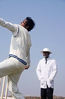 Bowler and the umpire during the match