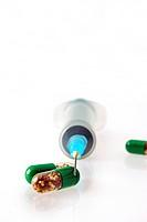 Extreme close up of Capsules and syringe
