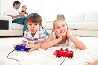 Adorable siblings playing video games