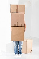 Young woman carrying cardboard boxes (thumbnail)
