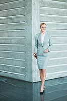 Germany, Stuttgart, Businesswoman standing with diary, smiling