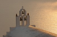 Greece, Bell Tower of whitewashed church and sea in background Imerovigli at Santorini