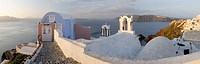 Greece, View of Oia village in warm morning light with cobbled path at Santorini
