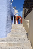 Greece, Colourful houses and cobblestone footpath in traditionally Greek village Oia at Santorini
