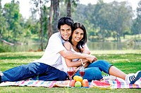 Couple out on a picnic at a park