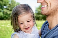 Gemany, Cologne, Father and daughter smiling, close up (thumbnail)