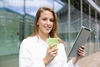 Europe, Germany, North Rhine Westphalia, Duesseldorf, Medical student with digital tablet, smiling, portrait