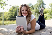 Europe, Germany, North Rhine Westphalia, Duesseldorf, Young student with digital tablet, smiling, portrait