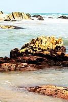 Waves hitting rock at a beach