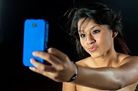 Teenage girl taking picture with cell phone, close up