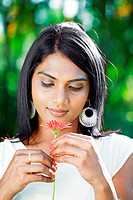 Close_up of woman holding a flower