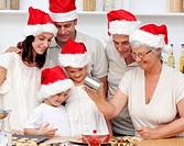 Happy family baking Christmas cakes