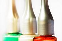 Nail polish bottles in tri colours