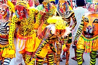 Men disguised as tiger during Onam