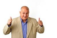 Portrait of an elderly man doing a thumbs up gesture