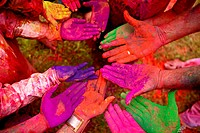Top angle view of human hands smeared with holi colour