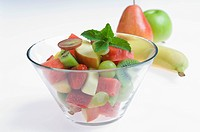 Bowl of fruit salad on white background