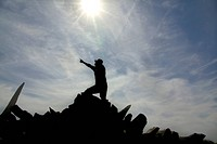 Germany, Mid adult man pointing at sky