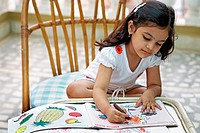 A young girl doing her home work