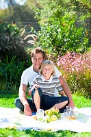 Father and son enjoying a picnic
