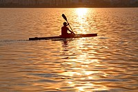 Man rowing a boat, silhouette