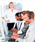 Female leader ma ging her working team in a call center