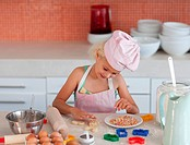 Young daughter baking at home