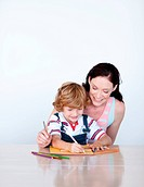 Mother helping her son to draw