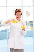 Beautiful scientist examining a test_tube