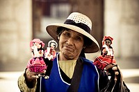 Woman selling hand_made dolls in Arequipa Plaza De Armas, Arequipa, Peru, South America
