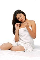 Young woman filing her finger nails