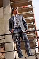Young businessman standing on a staircase