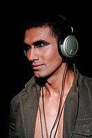 Close_up of a young man wearing headphones