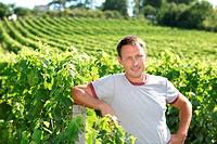 Winegrower standing in vineyard