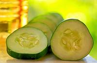 Cucumber slices and vinegar.