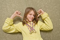Girl with medals around her neck