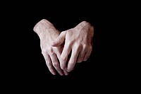 Hands of a man with black background